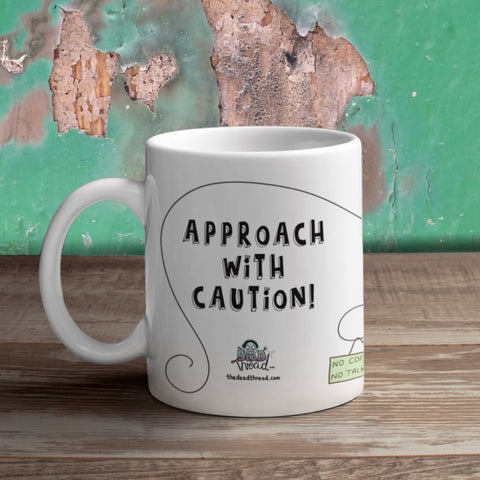 The Dead Thread™ Approach With Caution mug (female zombie)