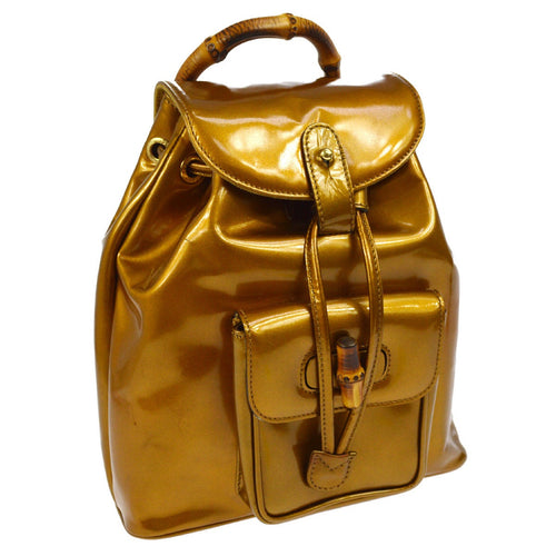 Gucci gold patent leather vintage mini backpack with gold-tone hardware