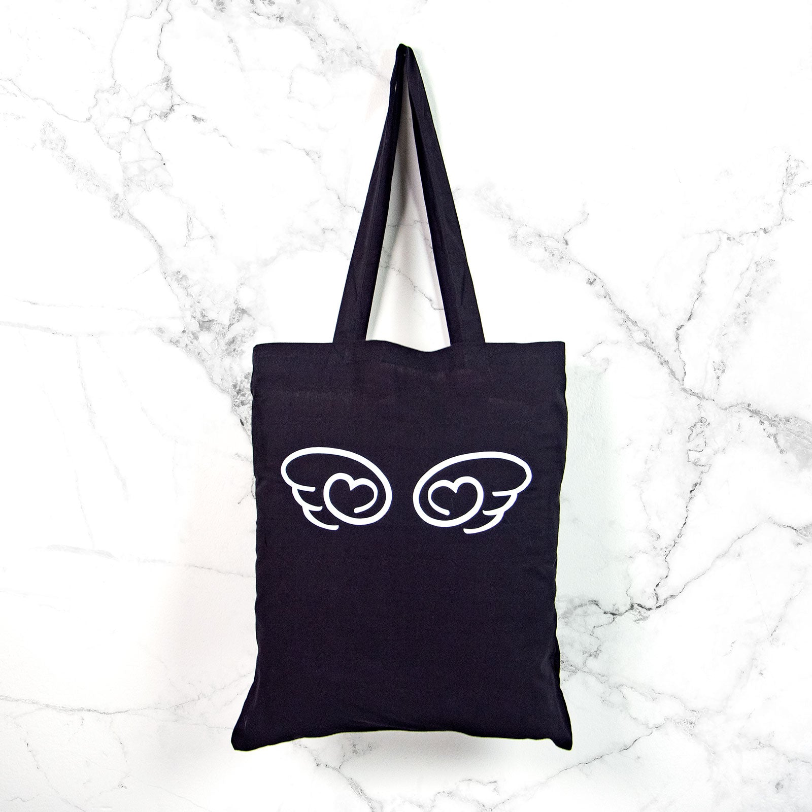 Dark fallen angel wing tote bag for pastel goth or soft grunge