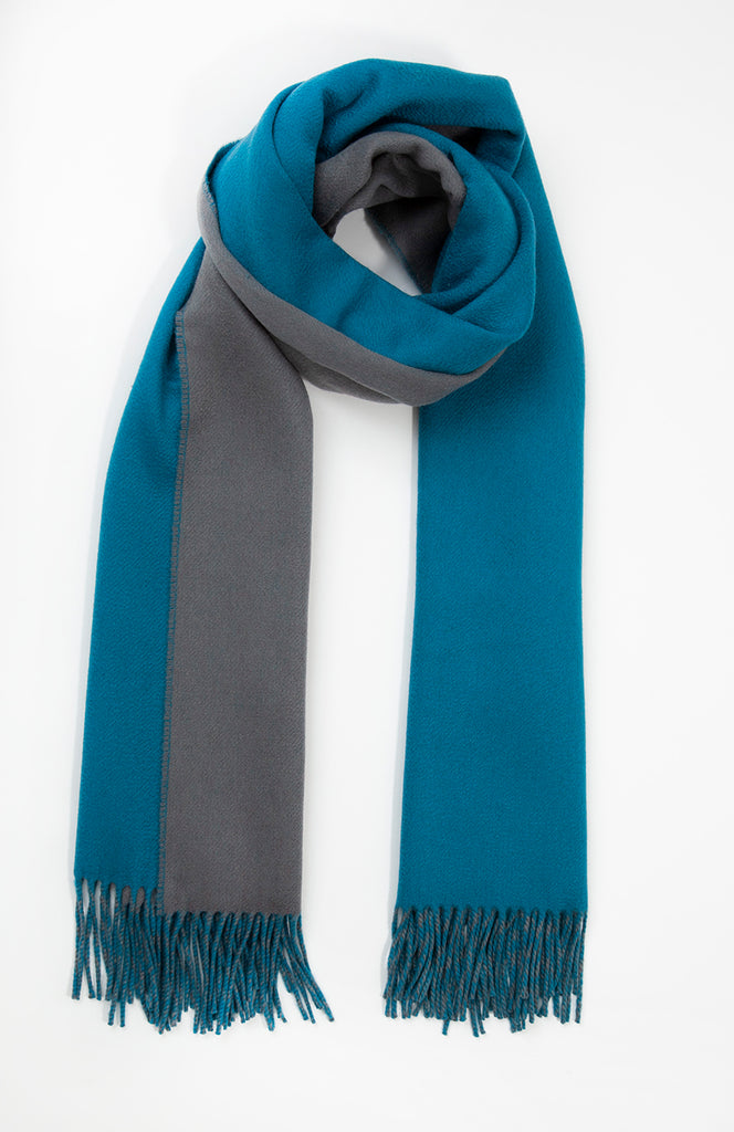 Marine and Grey Johnstons of Elgin double faced cashmere wrap scarf   Woven from the finest of cashmere fibres, hand-combed from the under-belly of goats in China and Mongolia where the dramatic highs and lows in temperature help them to grow their beautiful fleece – renowned for its extreme softness, warmth and lustrous quality, making it the perfect accessory for every occasion.