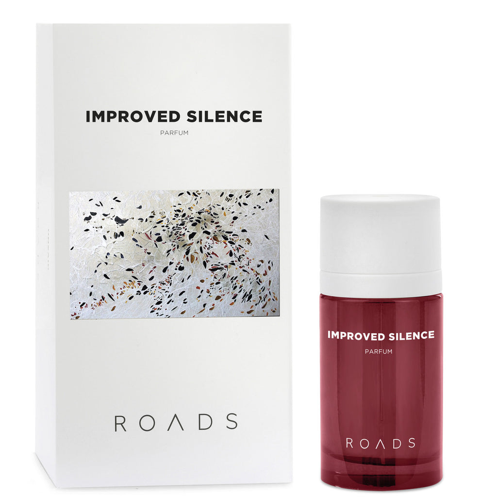 Improved Silence perfume by ROADS is a calm and enveloping fragrance comprised of soft, meditative notes. The perfume's packaging features artwork by June Katz, whose approach incorporates elements of technology, science, philosophy and music; drawing her inspiration from the way in which humans perceive and treat nature.  Top Notes: Citrus, Lavender Heart Notes: Rose, Violet, Almond Milk Base Notes: Woods, Vanilla
