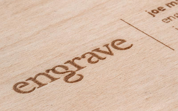 detail of laser engraved wood business card