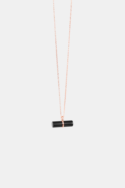 Rose gold plated necklace with horizontal pendant setting an onyx cylinder made in Germany