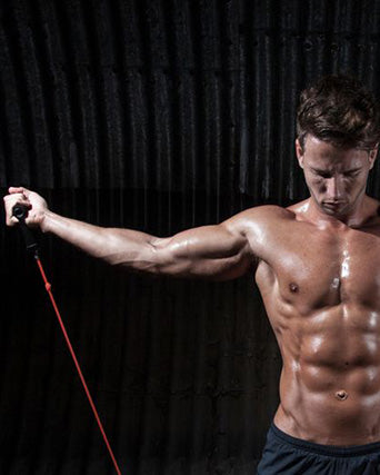 shredded-man-doing-resistance-band-chest-workout