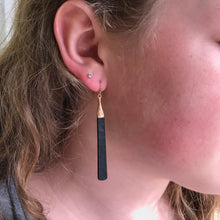 bar earrings of gold-tipped matte black
