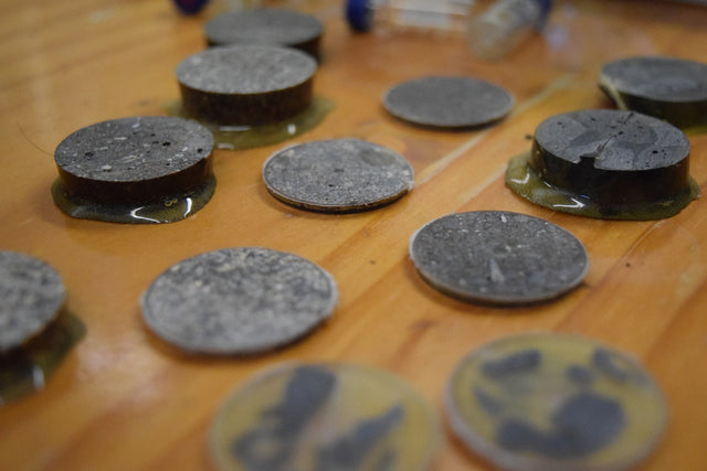 Multiple circular samples of geological samples ready for analysis