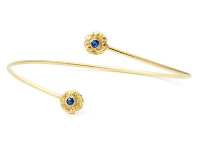 """Seaquin"" Bypass Bangle Bracelet with Blue Sapphires in 18kt Gold"