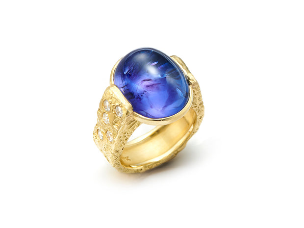 Oval Cabochon Tanzanite in 18kt Gold Textured Band with Diamonds