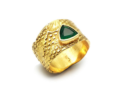 Trilliant Cut Emerald set in 18kt Gold Seascape Band