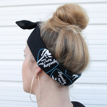 girl wearing rhythm and blues cruise bandana as a head wrap