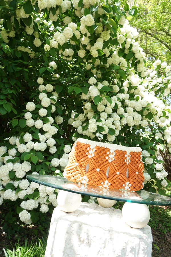 Orange and white clutch