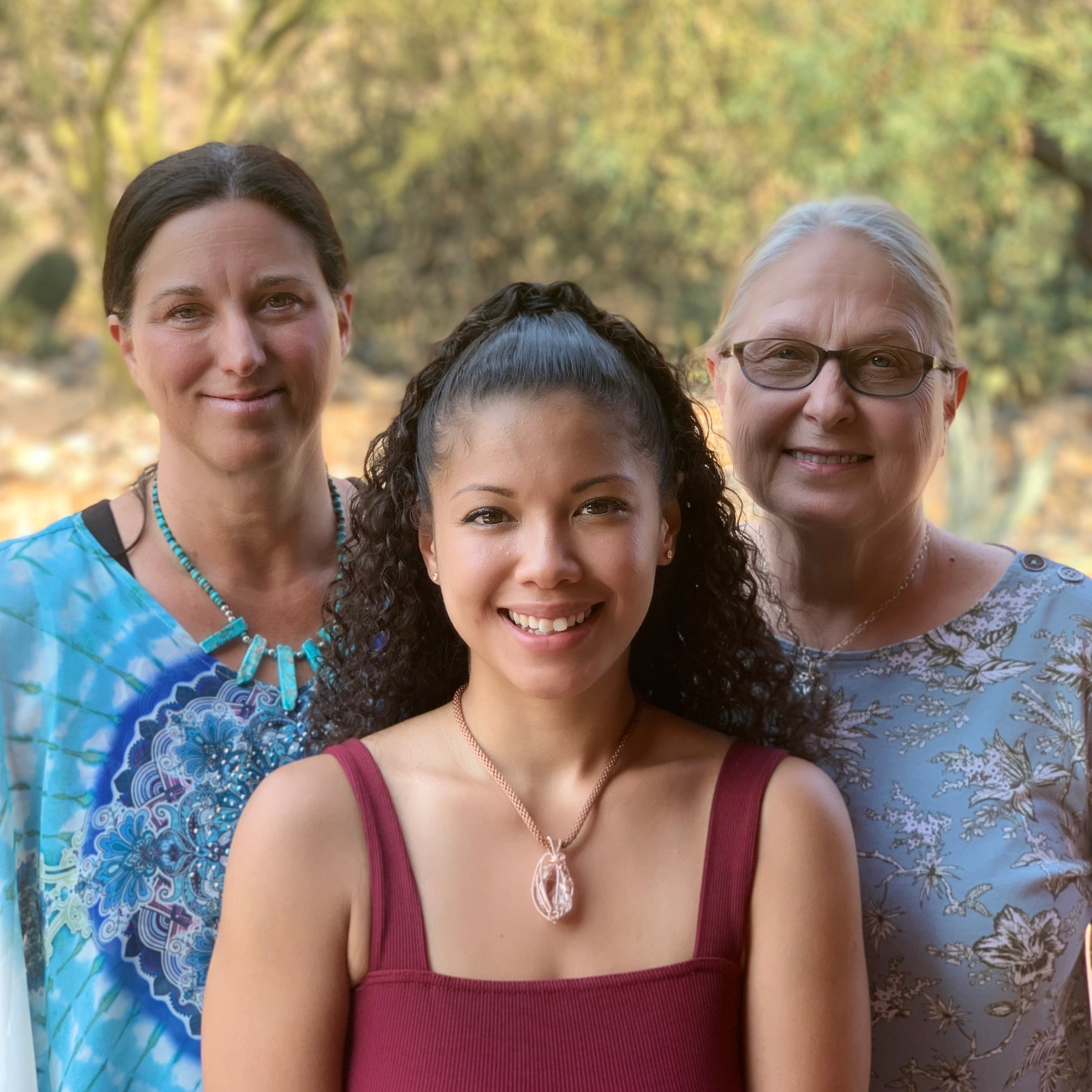 three woman representing the ancient element creations family