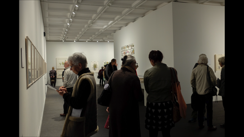 Exhibition with crowd of people at Lawrence Wilson Gallery Perth