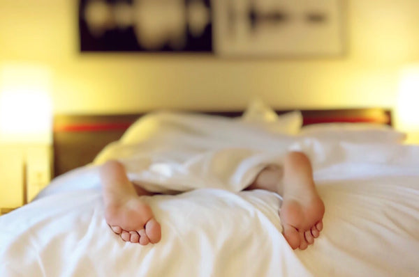 Woman's feet as she sleeps in comfy bed