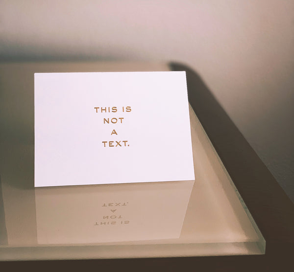 Invitation saying 'This is not a text'.