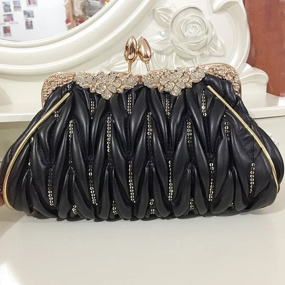 Black and gold clutchbag