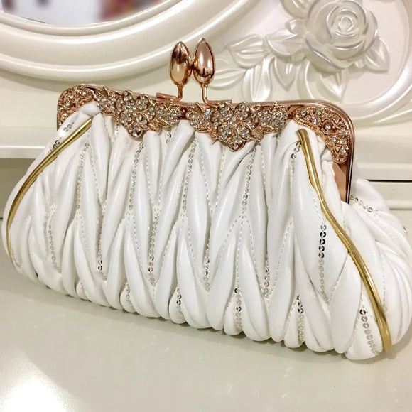White and gold clutchbag