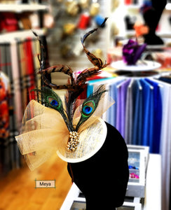 Cream gold and white Fascinator with peacock feather