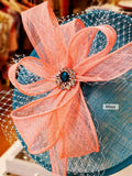 Teal blue and coral fascinator