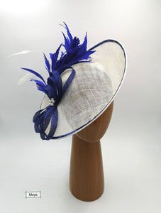 White cream and royal blue hat