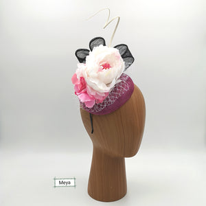 White pink black fascinator