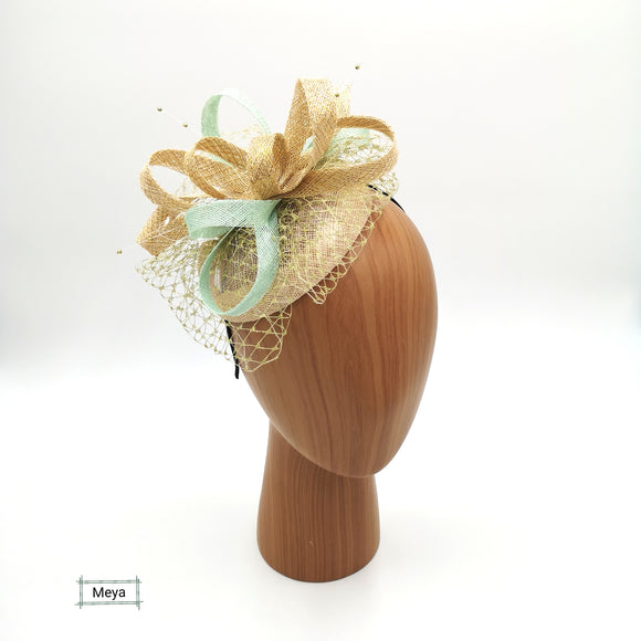 Gold and mint green fascinator