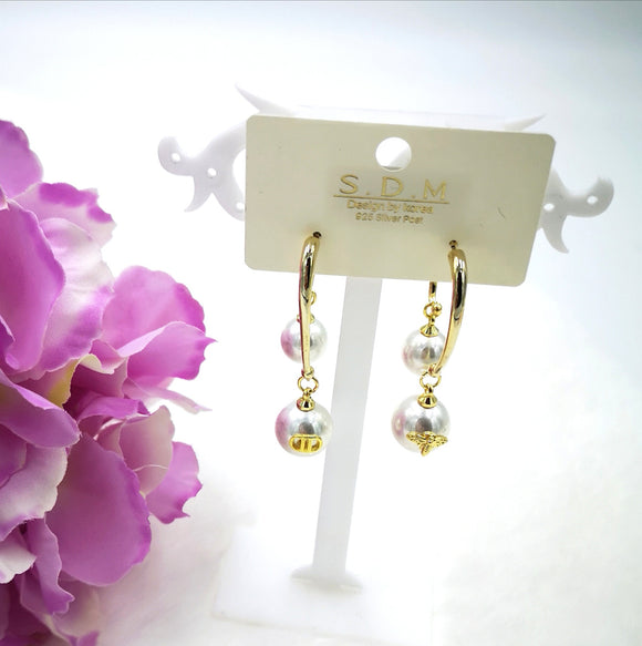 Pearls and gold earrings
