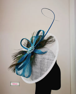 White fascinator with peacock feathers