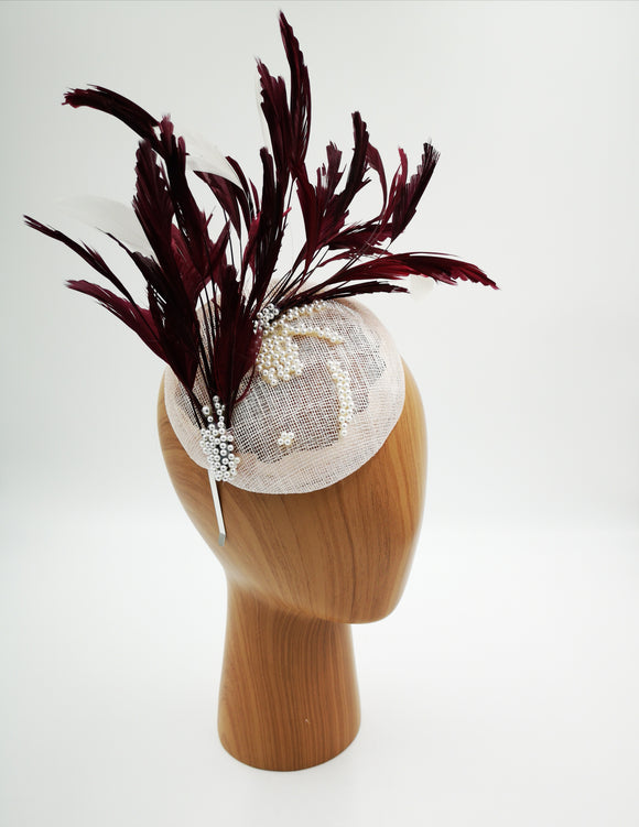 Baby pink and burgundy fascinator hat