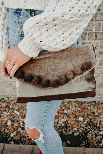 THE POM POM CLUTCH
