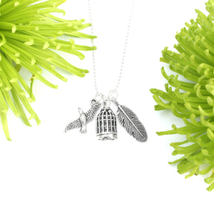 silver fly free bird birdcage charm necklace