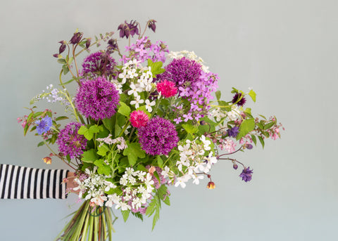 Locally grown flowers in a bouquet made by The Flower Folk