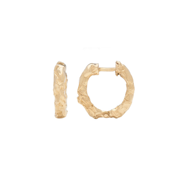 Our bestseller Alfa Hoops in 14-karat gold with Fie Isolde's raw signature look, in the perfect size hoop.     Sold as a pair or individually.       PRODUCT DETAILS:   Ear cuff in 14-karat gold.  Handmade in Los Angeles Hinged closure SIZE & MEASUREMENTS:  Hoop diameter: 15 mm  Hoop width : 3 mm
