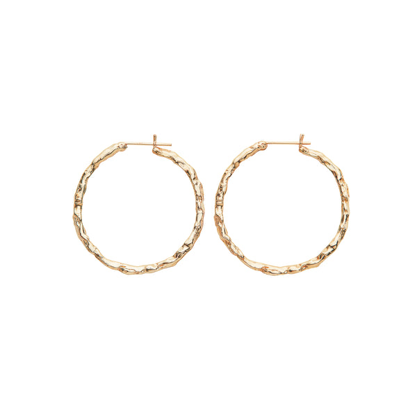 The biggest Alfa Hoops Mega in 14-karat gold. The hoops are simple and thin making them lighter and comfortable to wear.      PRODUCT DETAILS:   Alfa hoops in 14-karat gold.  Handmade in Los Angeles Hinged stud closure SIZE & MEASUREMENTS:  Hoop diameter: 35 mm