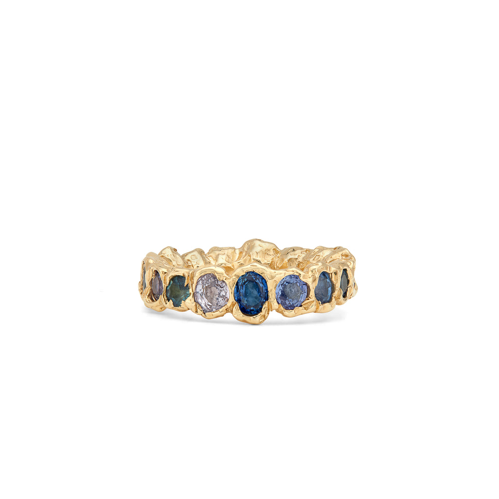 Our colorful statement, Freja Rainbow ring in 14-karat gold with Sapphires in a palette of blue shades. This cocktail ring has Fie Isolde's raw signature finish resembling liquid gold. The ring comes in a variety of different colors so if you do not see the color you would like, please contact us. PRODUCT DETAILS:   Ring in 14-karat gold with blue Sapphires.  Handmade in Los Angeles SIZE & MEASUREMENTS:  Ring hight: 6 mm