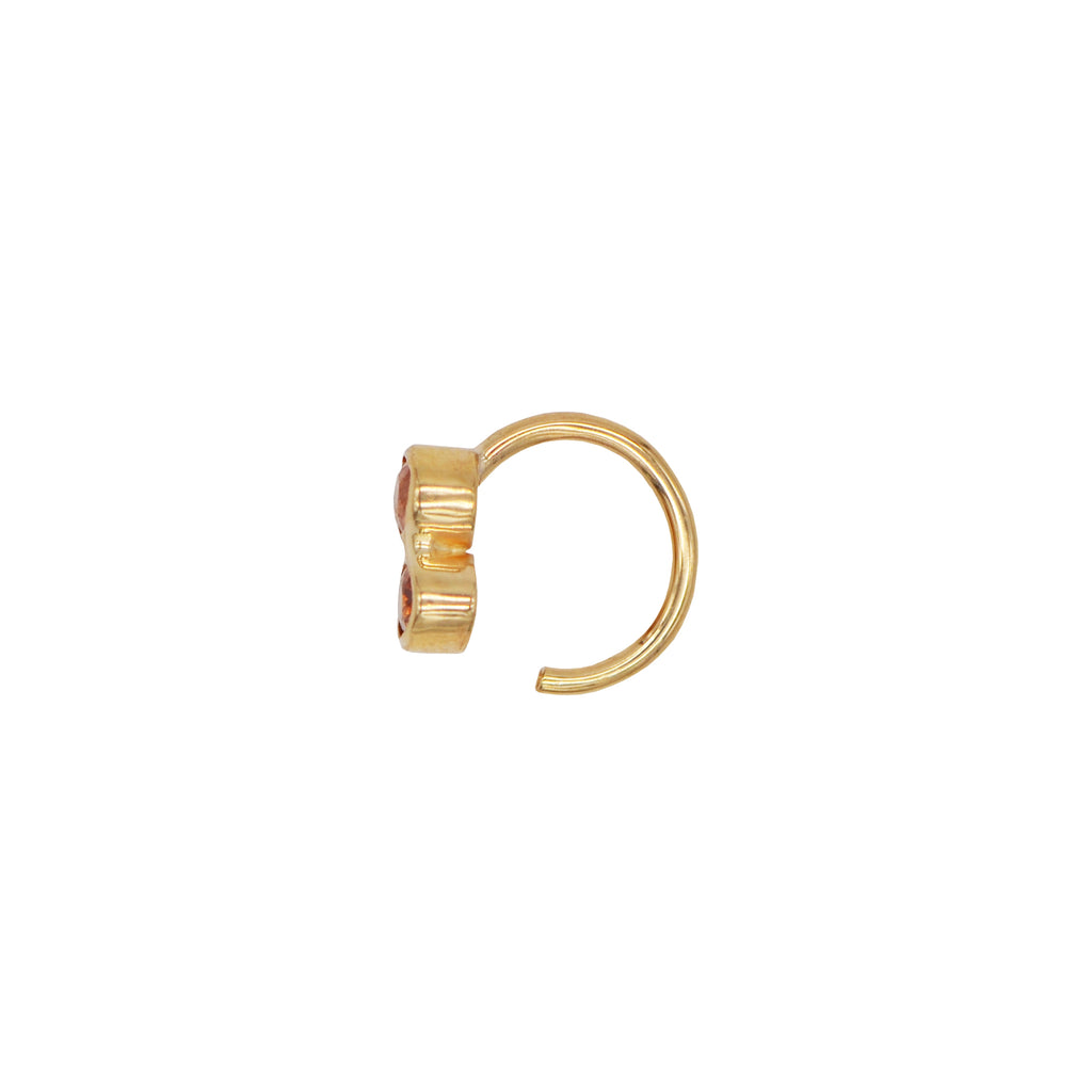 Our color pop, mini Freja hoop in 14-karat gold with a milky pink and an orange Sapphire.  PRODUCT DETAILS:   Ring in 14-karat gold with pink and orange Sapphires.  Handmade in Los Angeles Twist the hoop in the ear, no back closure SIZE & MEASUREMENTS:  Hoop diameter: 8-9 mm