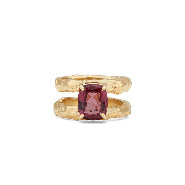 Our one-of-a-kind cocktail ring, The Odette Ring in 14-karat gold with a big dark purple cushion Garnet. The ring has a sporty vibe to it with the two simple bands connected by a big precious stone. PRODUCT DETAILS:   Ring in 14-karat gold with precious stone.  Handmade in Los Angeles SIZE & MEASUREMENTS:  Ring width: 10 mm