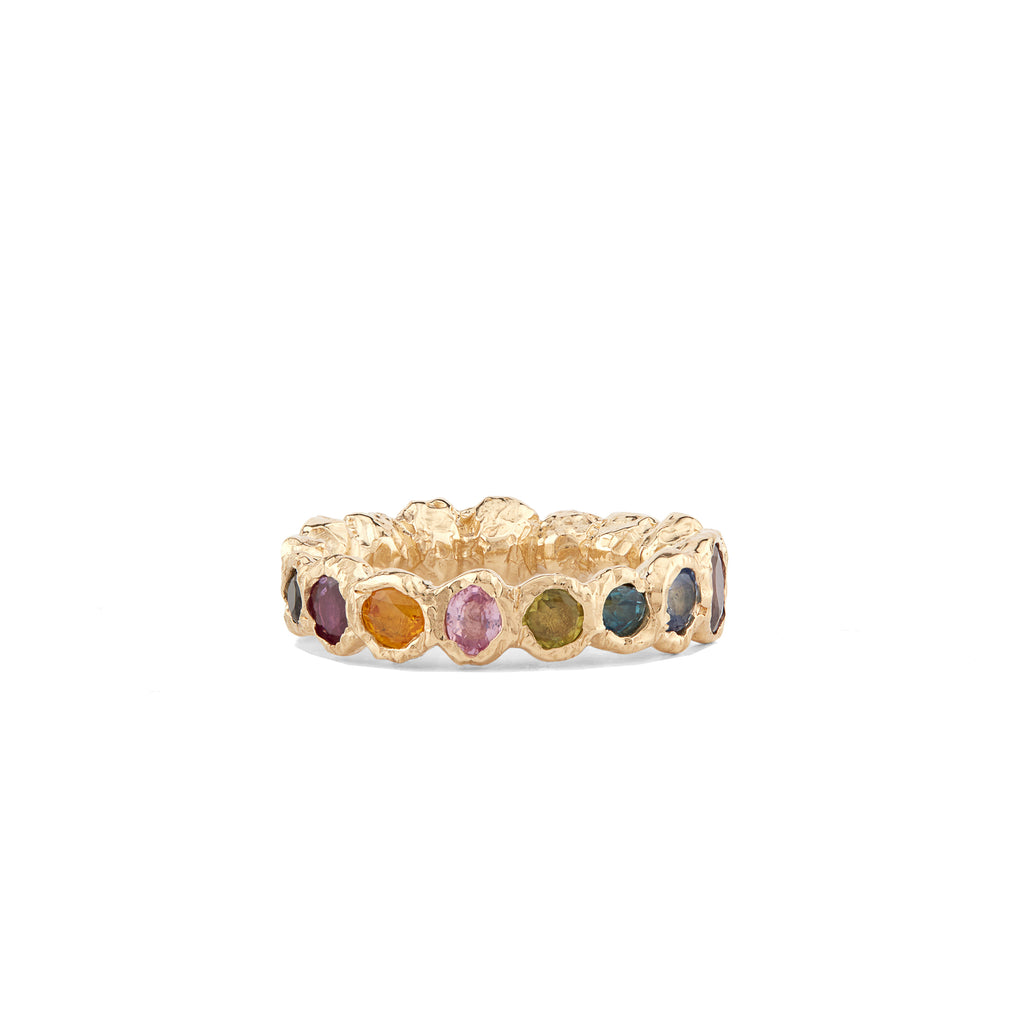 Our colorful statement, Freja Rainbow ring in 14-karat gold with 17 Sapphires in a palette of light multi-colored shades. This cocktail ring has Fie Isolde's raw signature finish resembling liquid gold.  PRODUCT DETAILS:   Ring in 14-karat gold with multi-colored Sapphires.  Handmade in Los Angeles SIZE & MEASUREMENTS:  Ring hight: 6 mm