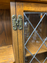 England Glass Cabinet with Ornate Details