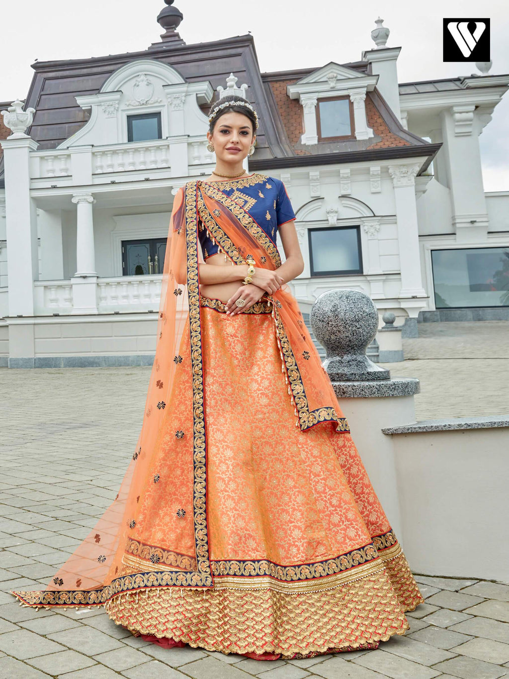Dramatic Dark Orange Jacquard Wedding Lehenga