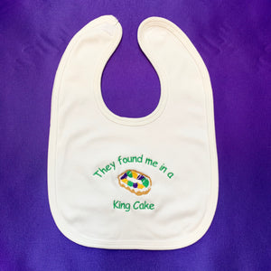 THEY FOUND ME IN A KING CAKE BABY BIB