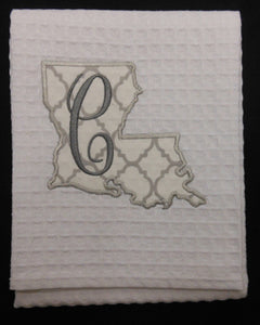 white Louisiana hand towel embroidered with the letter C