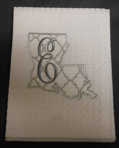 white Louisiana hand towel embroidered with the letter E