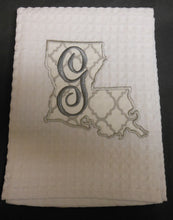 white Louisiana hand towel embroidered with the letter G