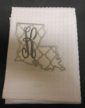 white Louisiana hand towel embroidered with the letter K