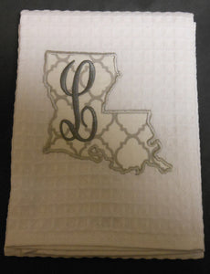 white Louisiana hand towel embroidered with the letter L