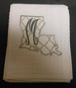 white Louisiana hand towel embroidered with the letter M