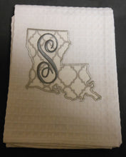 white Louisiana hand towel embroidered with the letter S