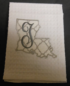 white Louisiana hand towel embroidered with the letter T