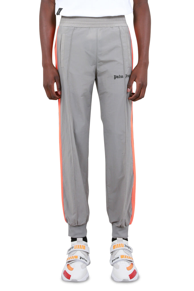 16fbdef7 Loose Fit Track Pants - Light Grey/Fluoro Orange. PALM ANGELS